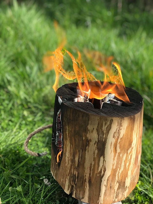 A Warma Swedish Fire Log, or Swedish Torch, burning