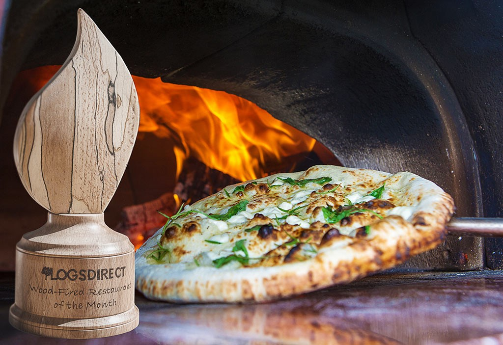 Woody Award with wood fired pizza oven in background
