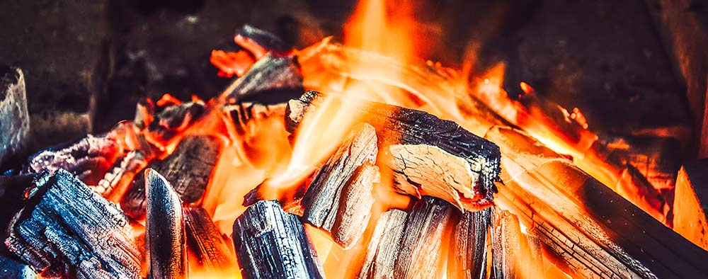 what to do with charcoal ashes after grilling